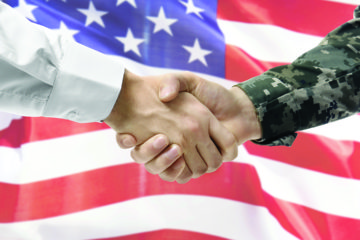 Veteran and Civilian shaking hands