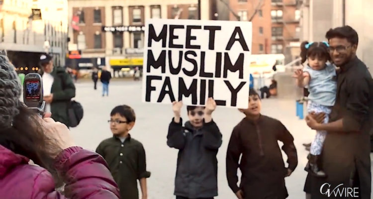 Muslim family with placard