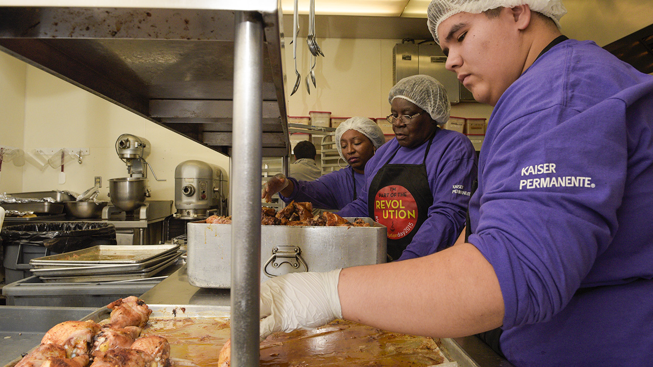 Sereda Crippen, Helena Opoku and A.J. Cervantes (l to r) prepare food. (photo: Randy Reed)
