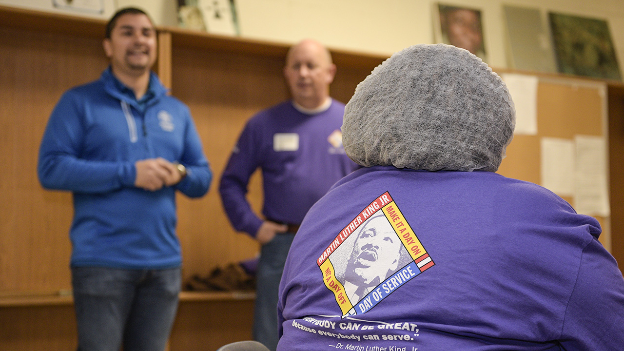 Volunteers from Kaiser Permanente Fresno spent the morning volunteering their time at the Poverello House. CEO Cruz Avila shares a his thanks before work begins.  (photo: Randy Reed)