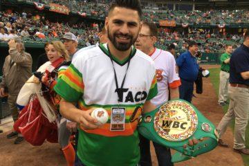 Photo of world boxing champion Jose Ramirez with his title belt