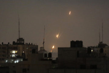 Flames from Palestinian rockets seen over the Gaza Strip