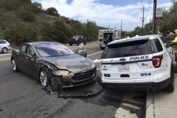 Crashed Tesla and police SUV in Laguna Beach, California