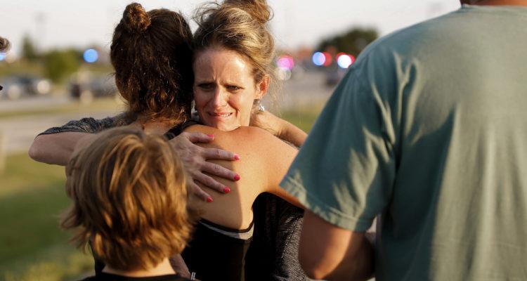 Jennifer Stong hugs Tasha Hunt .