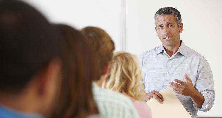Teacher speaking in front of class