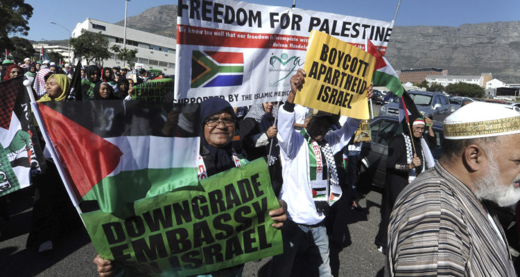 Protesters take part in a march to parliament in Cape Town, South Africa, Tuesday, May 15, 2018