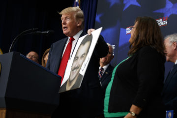 Photo of President Donald Trump speaking about immigrant crime