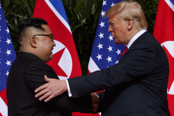 Photo of North Korea's Kim Jong Un and President Trump shaking hands