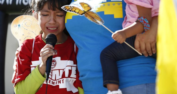 AP photo of child crying as she talks about being separated from her father