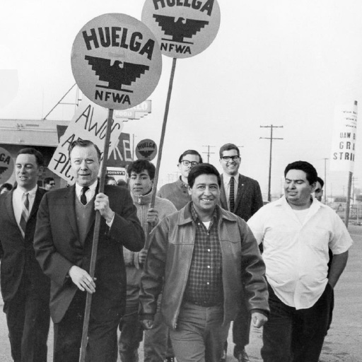 Photo of United Auto Workers President Walter Reuther carrying sign, along with Cesar Chavez, center, and Sal Gonzales Sr.