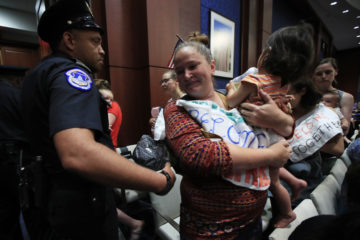 Photo of Lucy Martin and her daughter Branwen Espinal, who are removed from the hearing floor of the House.