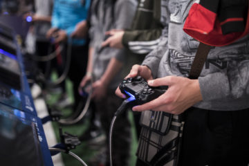 Photo of young men playing video games