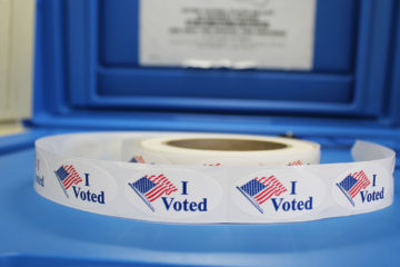"""Photo of a roll of """"I voted"""" stickers"""