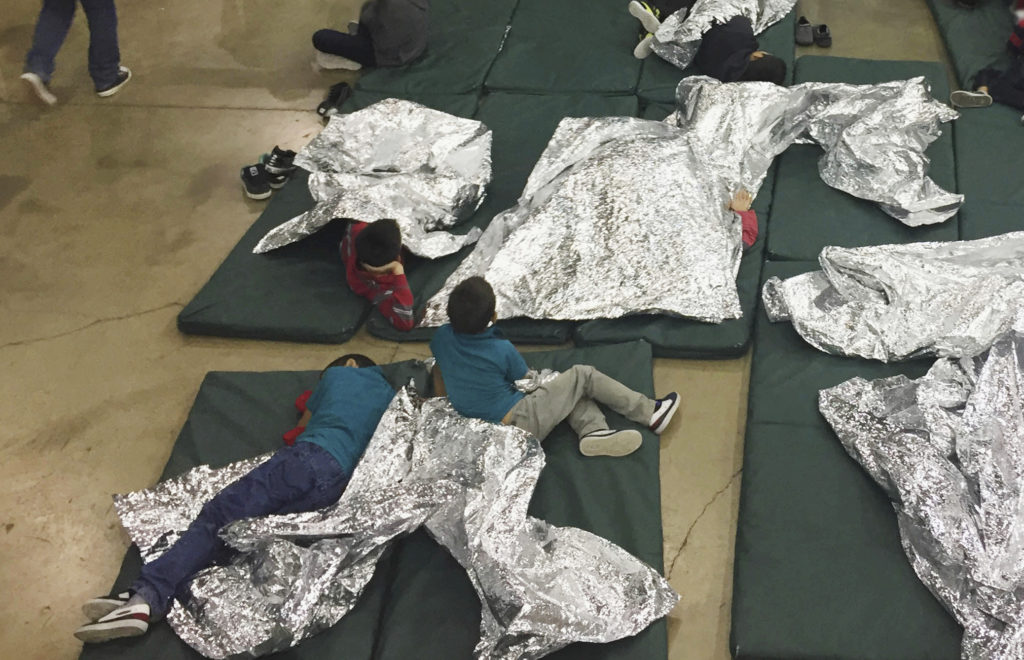 Photo of kids on floor of immigration holding facility in McAllen, Texas