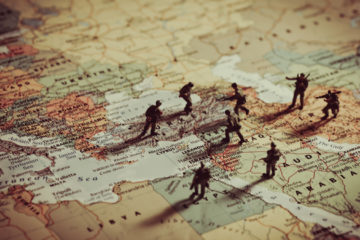 Photo Illustration of Toy Soldiers on a map of the Middle East.