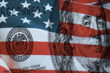 Federal Reserve Bank symbolized by American flag and Ben Franklin's image on a $100 bill