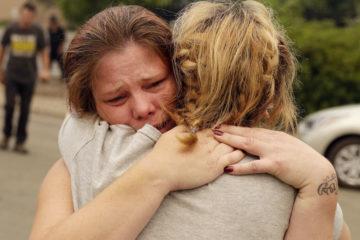 Photo of grieving Bledoe sisters