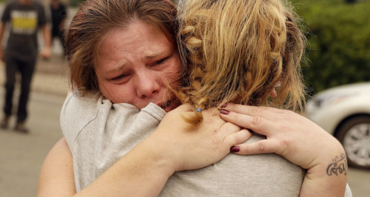 Photo of grieving Bledoe sisters