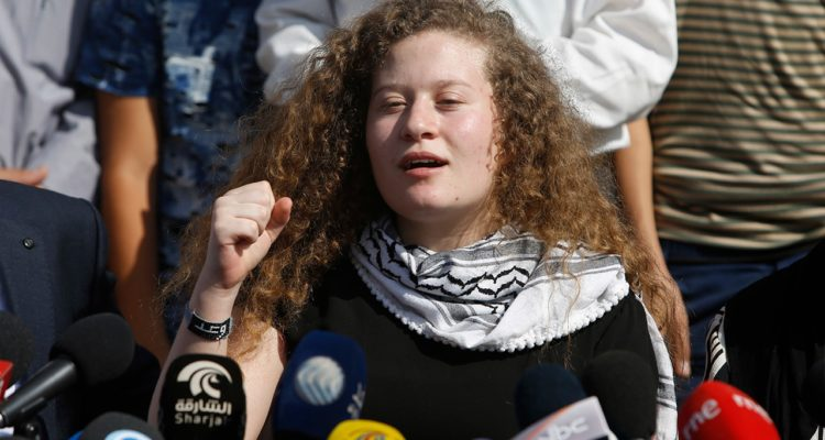 Photo of Ahed Tamimi speaking at a press conference