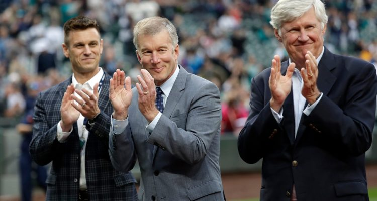 Photo of Seattle Mariners general manager Jerry Dipoto, left, president Kevin Mather, center, and majority owner John Stanton