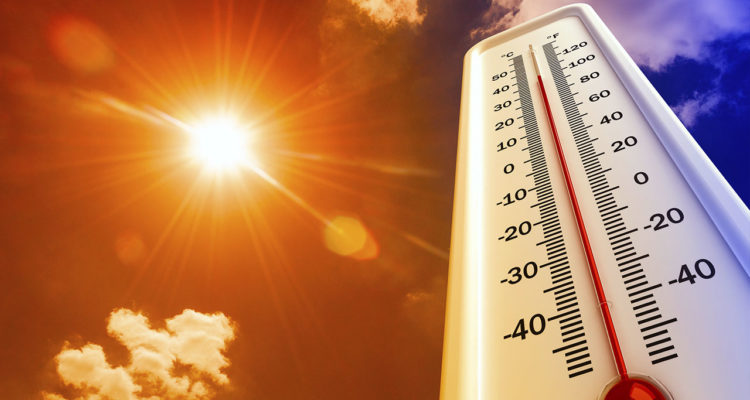 Photo illustration of heatwave and thermometer