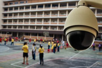 Photo of a security camera overlooking a school play yard