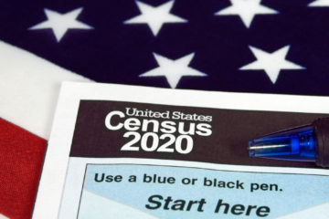 Photo illustration of American flag and 2020 census form