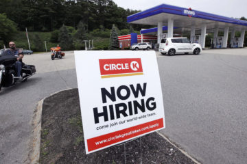 "Photo of a ""Now Hiring"" sign"