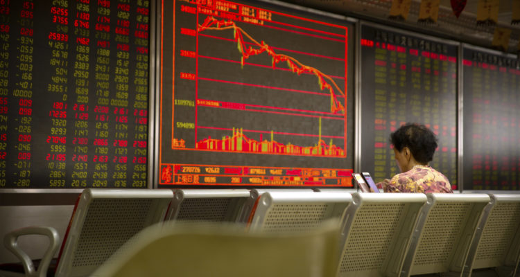 Photo of a Chinese investor monitoring stock prices