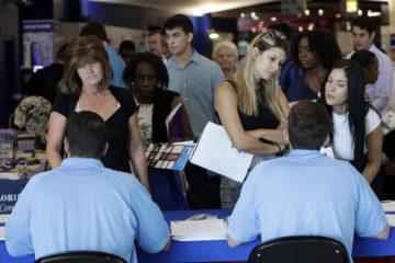 Job applicants talk with hiring rerpresentatives