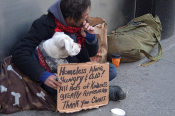 Photo of a homeless man and his dog in New York City