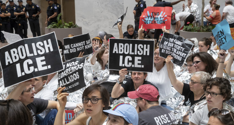 "AP photo of activists carrying ""Abolish I.C.E."" signs"