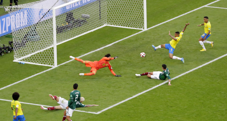 AP Photo of Neymar right before he scores against Mexico