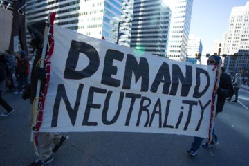 Photo of protestors advocating for net neutrality