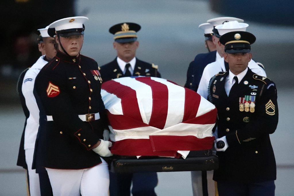 Photo of Armed Forces carrying John McCain's flag-draped casket