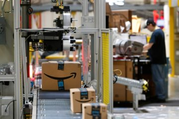 Photo of Amazon packages passing through a scanner at an Amazon fulfillment center in Baltimore
