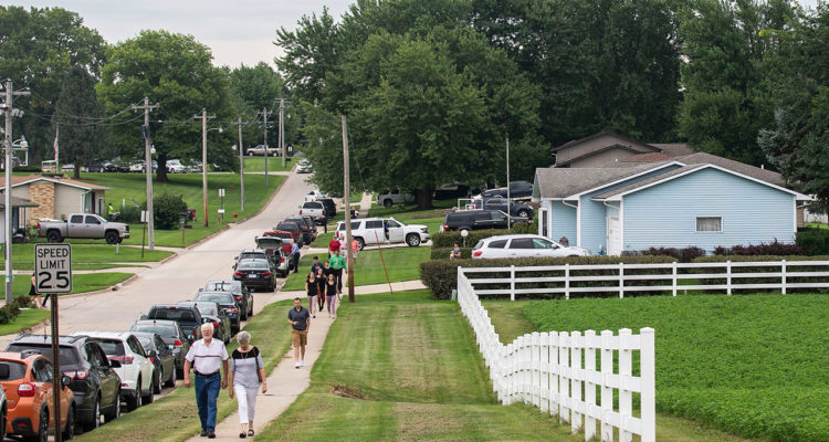 Photo of people walking blocks to attend Mollie Tibbetts' funeral in Brooklyn, Iowa