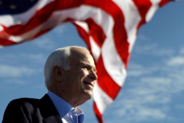 Photo of John McCain in front of an American flag