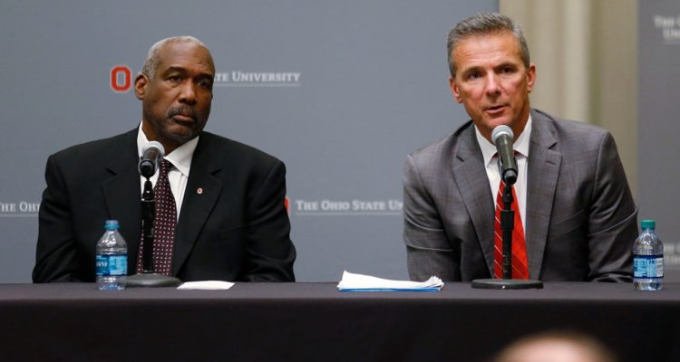 Photo of Urban Meyer answering questions during a news conference in Ohio