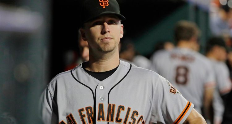 Photo of San Francisco Giants' Buster Posey walking in the dugout