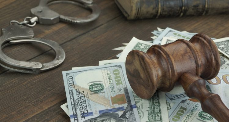 Stock photo of money, gavel, and handcuffs