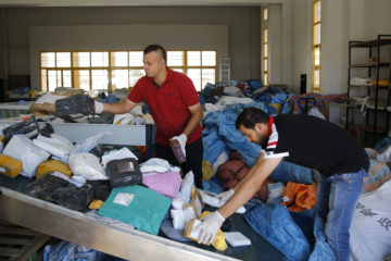 Palestinian postal workers sort through 8 years of mail held by Israel.