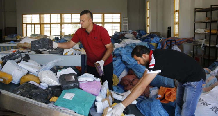 Palestinian postal workers sort through 8 years of mail held by Israel.