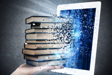 Photo Illustration of a pile of books being absorbed by a laptop