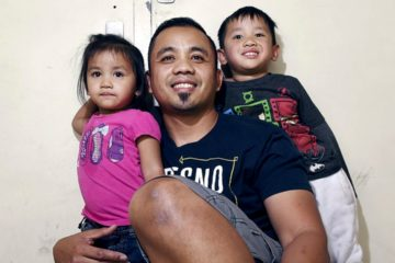 Photo of pardoned minister Vanna In and two of his children