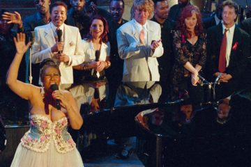 Photo of Aretha Franklin performing at an AIDS benefit concert