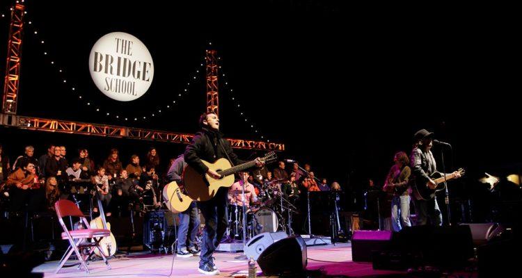 Photo of Pearl Jam performing during the Bridge School Benefit concert
