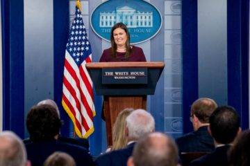 Photo of Sarah Huckabee Sanders speaking during press brief at the White House