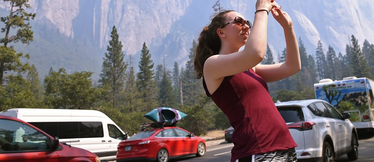 Photo of a girl photographing the south wall of Yosemite