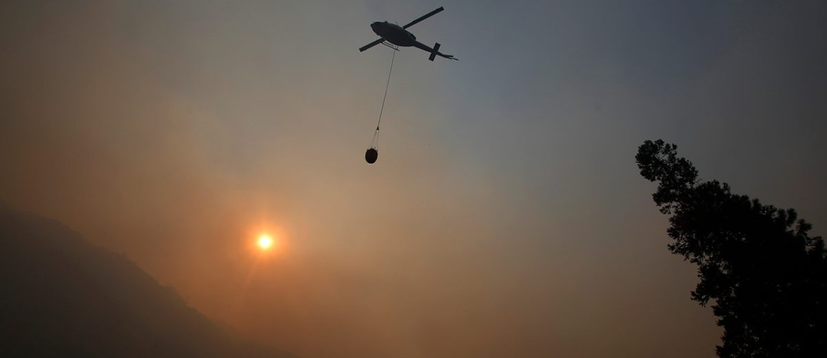 Photo of helicopter within the smoke of Yosemite wildfires